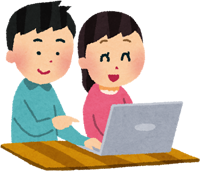 パソコンを使う男女のカップル