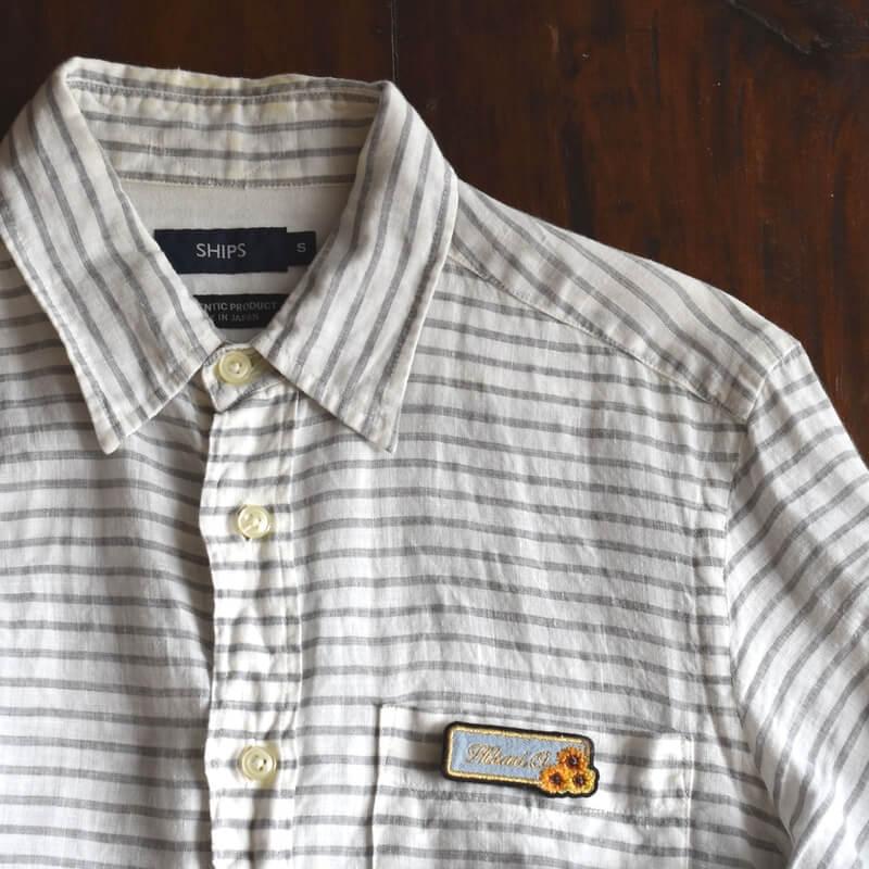 ミニマム向日葵刺繍ネ-ムプレ-トシャツへ