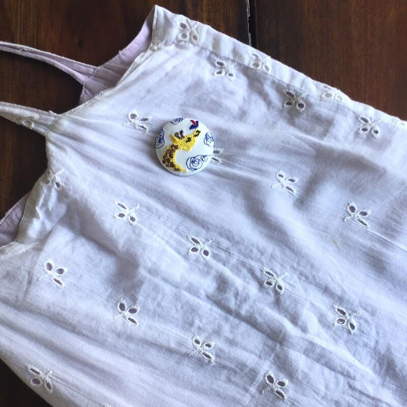 キリンと小鳥刺繍くるみ38綿バック